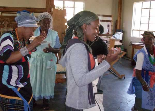 mapusha weavers dancing and singing in their studio